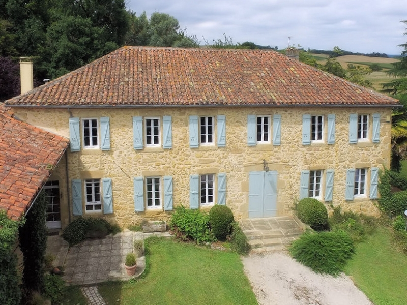 A leafy driveway leads up to this fine stone built maison de maitre