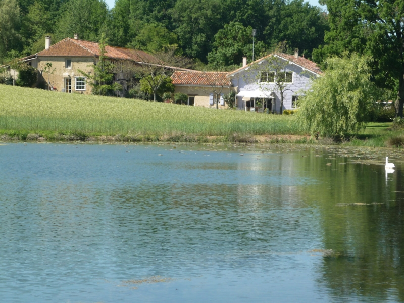 A charming property overlooking your own private lake.